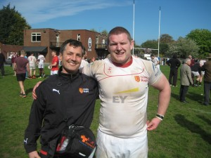 Dr Martin Kelly- recent Munster Rugby signing and hopefully future tight head prop- with David after the Trinity's last competitive match for season 2013/14 in which Trinity defeated Shannon.